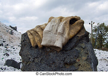 Work gloves lying on a rock