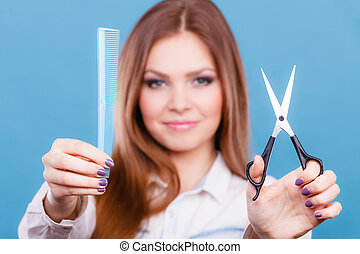 Work hairdo coiffure hairstyle concept. Female hairdresser presenting tools. Young professional beautican cheerfully showing her job.