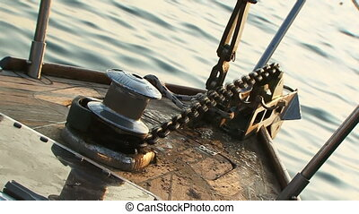 Work hoist - The process of lifting a heavy anchor with a...