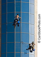 Work - Image of people climbing up the wall of building