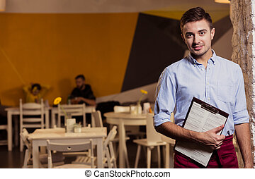 Work in gastronomy - Young waiter and work in small ...