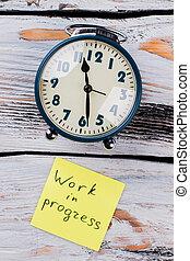 Work in progress concept flat lay. Vintage alarm clock on ...