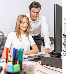 work in progress - Man and woman working together at the...
