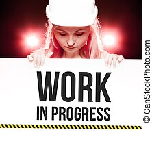 Work in progress sign held by worker - Work in progress sign...