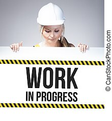 Work in progress sign on information poster, worker woman -...