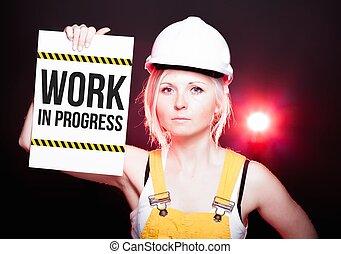 Work in progress sign placed on information board, worker...