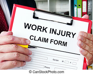 Work injury claim form is in man hands.