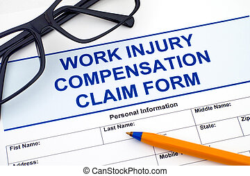 Work Injury Compensation Claim Form with pen and glasses.