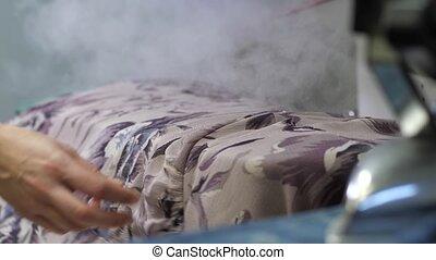 Work of industrial steaming machine in dry clean