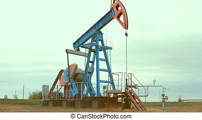 Work of oil pump jack on a oil fiel - Oil and gas industry....