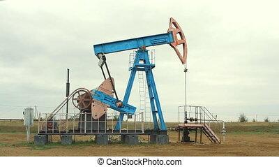 Work of oil pump jack on a oil field. - Work of oil pump...