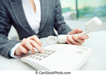 Work of secretary - Businesswoman dialing telephone number