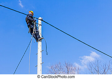 Work on a pole - Technician works high up on a power pole