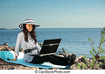 work on air - woman with laptop sea background