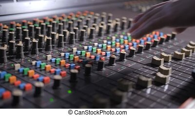 Work on mixing audio console in record studio - Close up of...