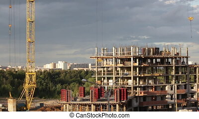Work on the construction site. Erection of the reinforced...