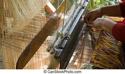 Work on the old loom. Laos, Luang Prabang