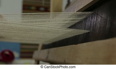 Work On The Weaving Loom - Weaving a carpet on a loom