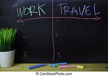 Work or Travel written with color chalk concept on the blackboard