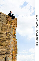 Work outdoor - View of businessman sitting on the top of...
