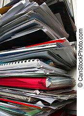 Work Overload - pile of magazine
