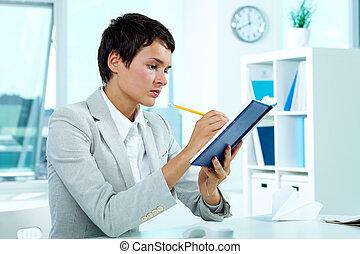 Work planning - Photo of smart businesswoman planning her...