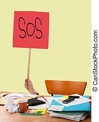 Work problem, overwork etc. SOS sign over untidy desk.