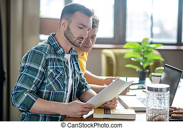 Two young men working remotely from home