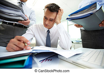 Work rush - Perplexed accountant doing financial reports...