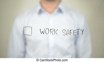 """""""Work Safety,  Man writing on transparent screen"""""""