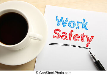 Work Safety - Text Work Safety written on the white paper...