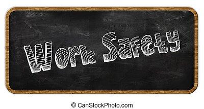WORK SAFETY written in chalk on blackboard. Wood frame.