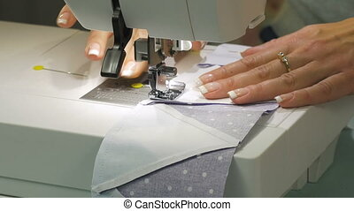 Work sewing machine with a cloth. Close-up. HD