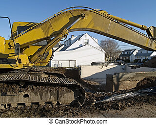 Work Site - A bull dozer frames this work site where a ...