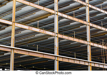Work site and large multistory steel frame of a large commercial building