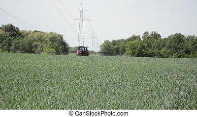 work spraying crop - seasonal farm work with field...