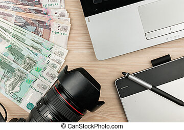 Work table designer, photographer and earned money rubles.