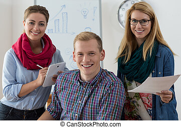 Work team of young adults at office