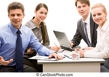 Work team - Photo of successful business partners sitting at...