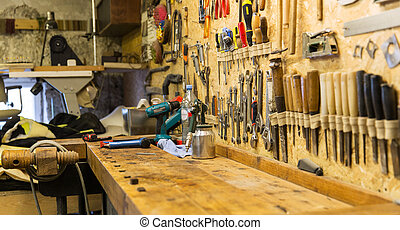 work tools and workbench at workshop - carpentry, woodwork...