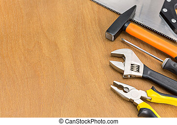 Work tools on wood background