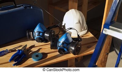 Work tools - toolbox with instruments, helmet, protective mask, pliers, tape and screwdrivers