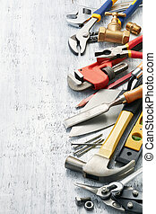 work tools - variety of tools on white textured background...
