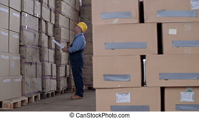 Work under Supervision - Laborer unloading packages from...