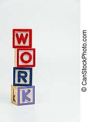WORK word wooden block arrange in vertical style on white background and selective focus