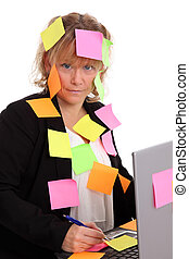 Businesswoman with post-it notes all over her. White background.