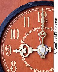 Closeup view of antique clock face. Nine o`clock.