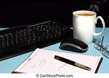 Work desk with computer mother board with cup of coffee and notepad