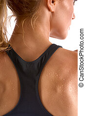 Worked out - Sweaty female in sports outfit (back view)