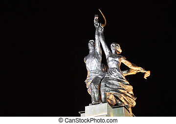 Worker and Collective Farm monument in Moscow at night,...